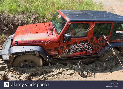 jeep stuck in mud jeep wrangler get stuck in mud stock photo royalty free