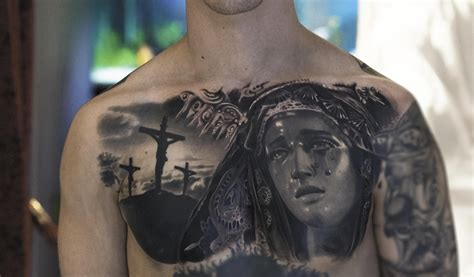 black and grey cross tattoo hyperrealist tattoos with an italian flair with
