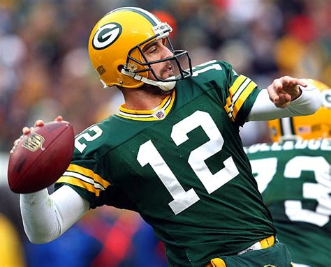 aaron rodgers and the green bay packers then and now the ultimate football coloring activity and stats book for adults and books report aaron rodgers says i ll be back and ready to go