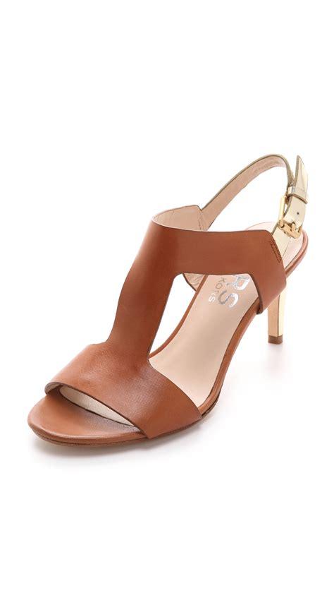 michael kors heel sandals kors by michael kors xyla low heel t sandal in brown