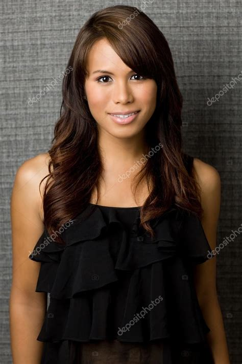 hair color for graying hispanic women sexy hispanic woman on textured background stock photo