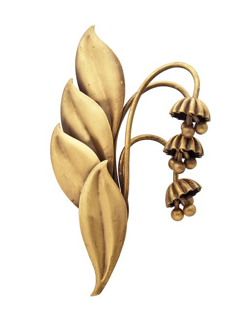 a gilt metal brooch composed of a spray of bell flowers