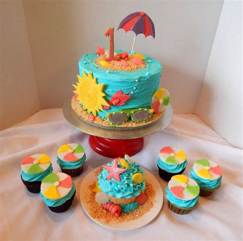 themed birthday cupcakes beach themed first birthday cake and cupcakes