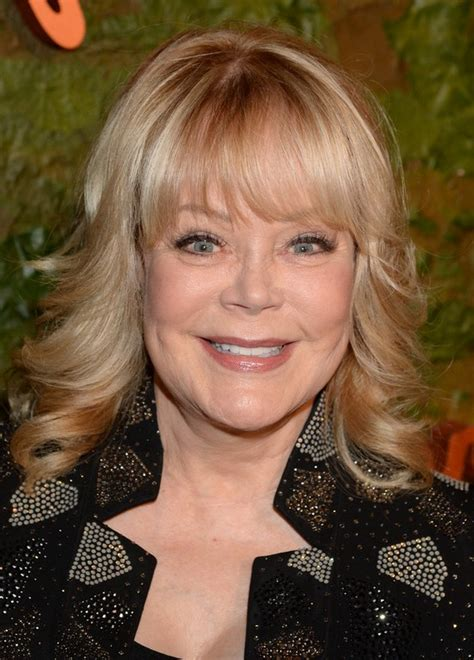 hairstyles with bangs for women over 60 candy spelling medium blonde curly hairstyle with bangs
