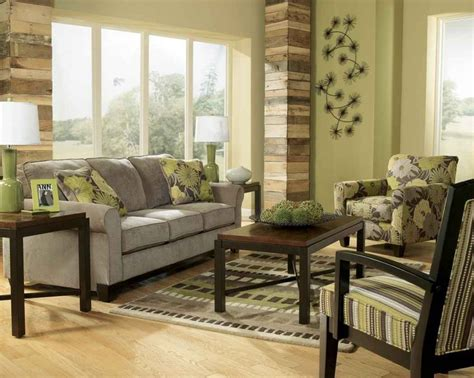 earth tone living room ideas earth tone living room with green wall paint and gray sofa