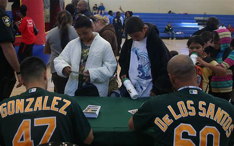 Oakland A S Backpack Giveaway - oakland a s stars free backpacks a hit with richmond students richmond confidential