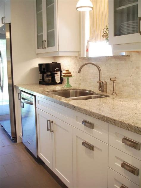 white kitchen cabinets with brushed nickel hardware white shaker style cabinets with modern brushed nickel
