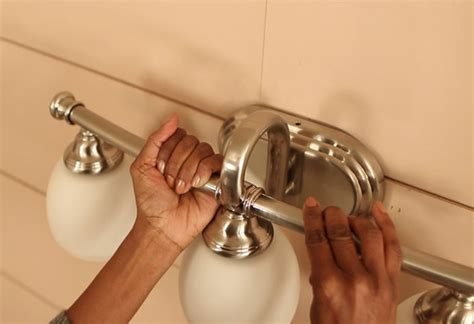 how to install light fixture in bathroom how to install a bath vanity light at the home depot