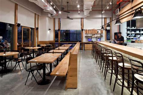 loft design e cafe industrial look wood and concrete for giraffe restaurant