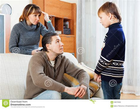 mom and son have in livingroom parents berating teenager son stock photo image 59675092