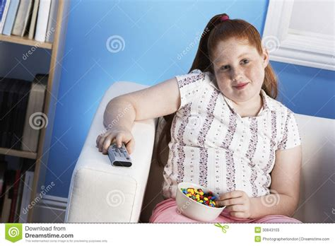 woman eats couch overweight girl with remote control eats junk food on