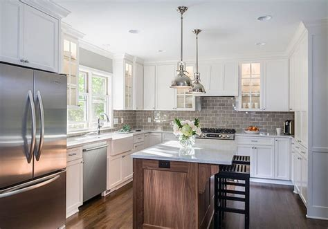 transitional kitchen with gray cabinets and farmhouse sink farmhouse sink gooseneck faucet grey color scheme white