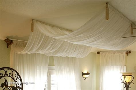 drapes on ceiling bedroom drape curtains on ceiling over bed pretty this could