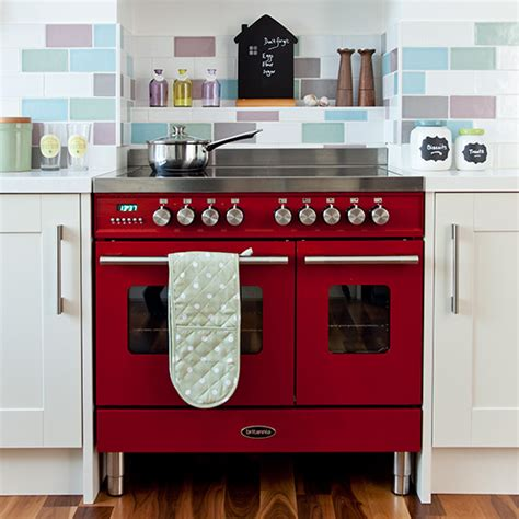 Homebase Kitchen Design by Country Kitchen With Red Range Cooker And Pastel Wall