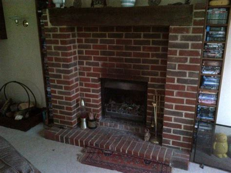 Large Brick Fireplace by Rudloe Fireplace And Invicta Stove Installation