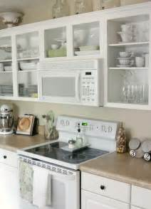 open cabinets in kitchen over the range microwave and open shelving