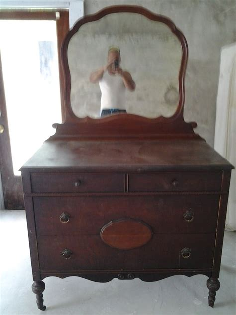 Antique Dresser With Mirror On Wheels i an antique dresser that has wooden wheels a mirror