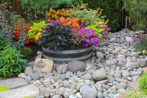 Whiskey Barrel Planter Drainage by Wshg Net A Steep Slope Is Turned Into A Garden Paradise