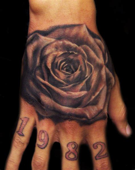 black and grey rose tattoo on hand black and grey rose tattoo on hand