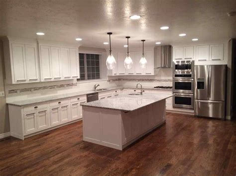 pictures of kitchens with white cabinets and wood floors