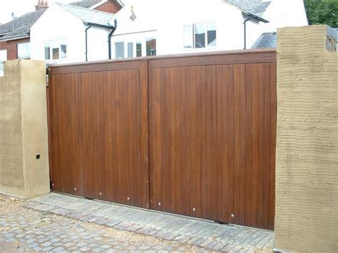 Nice Garage Doors Maintenance Services #5: Sliding%20gate%20Hardwood%20-large.jpg