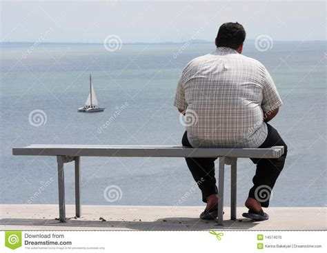 sitting the bench a man sitting on the bench stock photo image 14574070