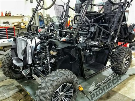build your own honda atv 30 000 honda pioneer 1000 build sneak peek side by side