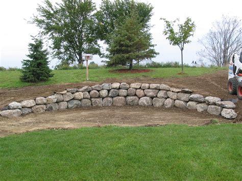 boulder wall retaining landscape