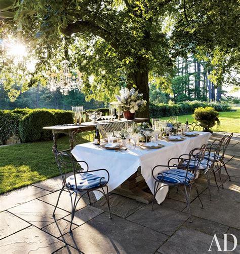 outdoor terrace gardens arranging plants patio stones furniture
