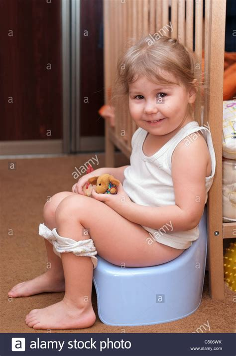 very young little russian girls little russian girl sitting on a chamber pot in the room