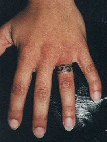 tribal wedding band tattoos ring finger
