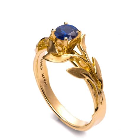 leaves engagement ring 18k yellow gold and sapphire