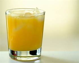 glass of orange juice with some vodka 61 366