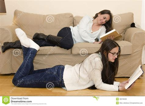 lying on the sofa women lying on sofa stock image cartoondealer com 90502093
