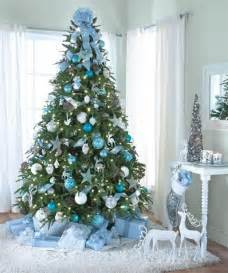 tree decorating with blue ornaments and