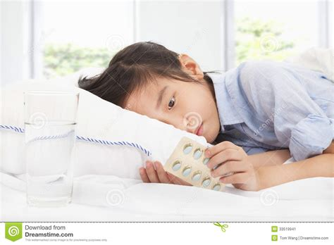 bed medicine sick little girl holding medicine stock image image
