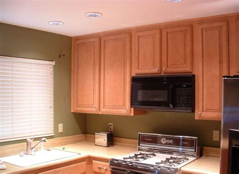space between kitchen cabinets and ceiling ways to fix space wasting kitchen cabinet soffits