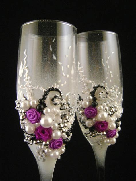 Gorgeous wedding champagne glasses, hand decorated with