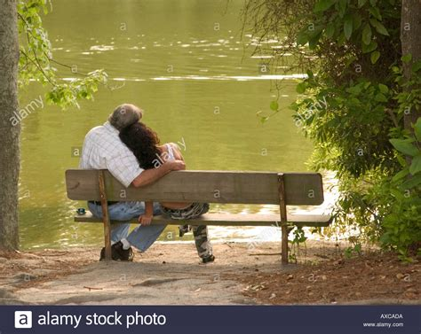 ita italy rome lovers on a park bench in the park of