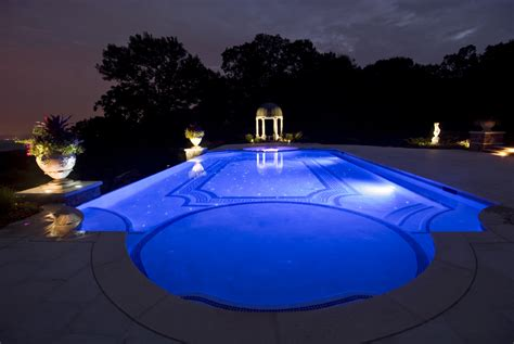 night view of roman style swimming pool with deck jets swimming pool renovations nj pool restoration repair