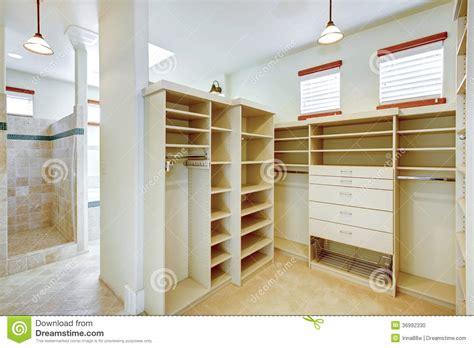 Small Bathroom Layouts With Shower Only bright warm bathroom combined with walk in closet stock