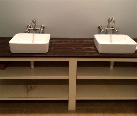a bathroom vanity made out of a stained cedar plank