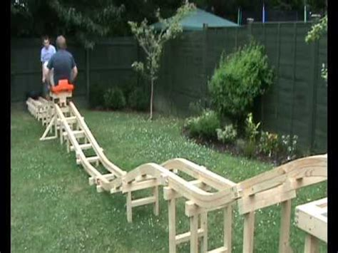 diy backyard roller coaster homemade roller coaster part 4 us riding on it youtube