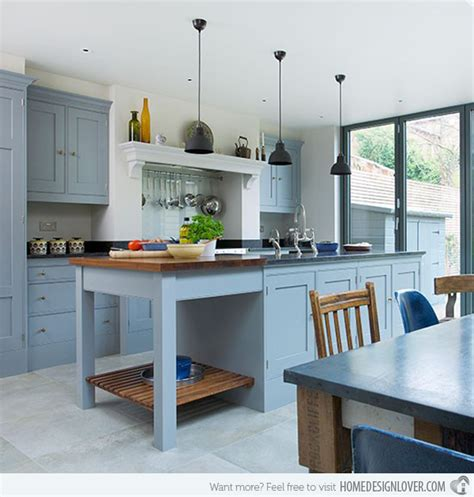 Blue Gray Kitchen Cabinets subtle shade of blue grey and ceramic flooring blue kitchen pendants
