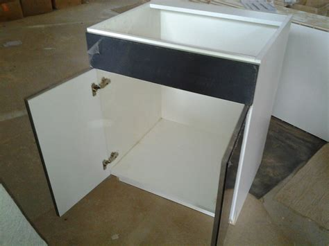 Concealed Cabinet Doors by Materials Masterwork Cabinetry Company Ltd