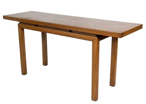 flip top console table or dining table in the manner of