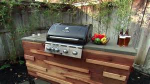 build a barbecue grill island from redwood posts and paver
