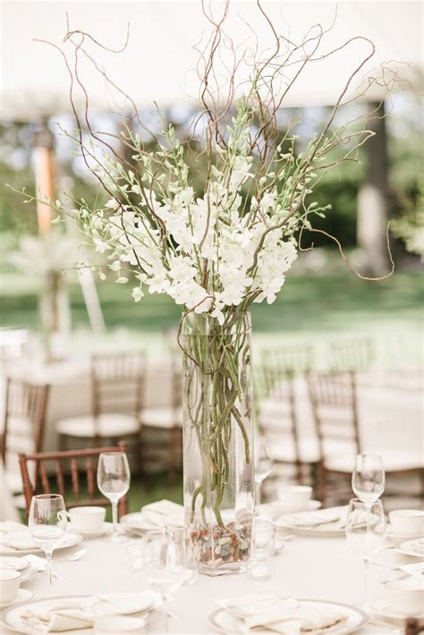 white stock and branches centerpiece
