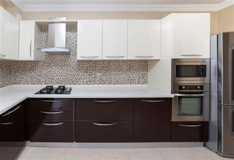 white or brown kitchen cabinets brown cabinets white appliances brown and white kitchen