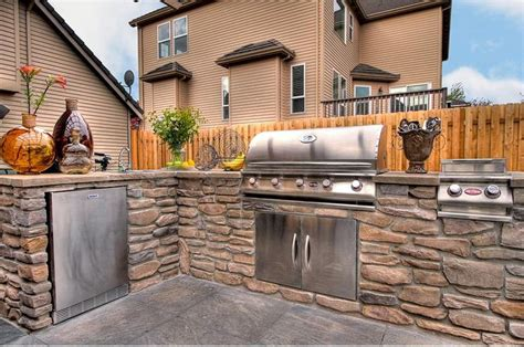 the backyard kitchen custom outdoor kitchen by paradise restored landscaping